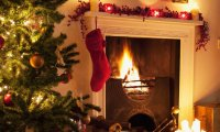Family Christmas celebrations round the fireplace